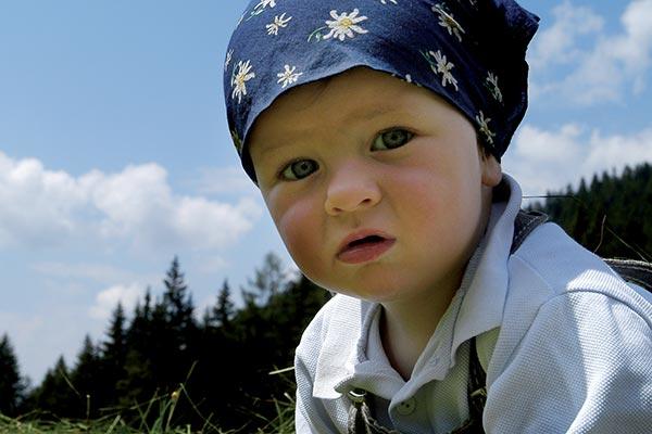 Kind im Urlaub auf der Seiser Alm