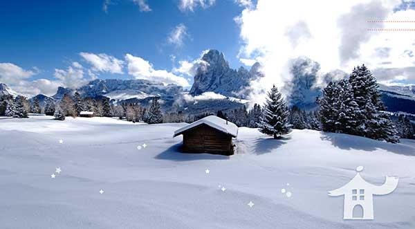 casetta sulla neve delle Dolomiti all'Alpe di Siusi